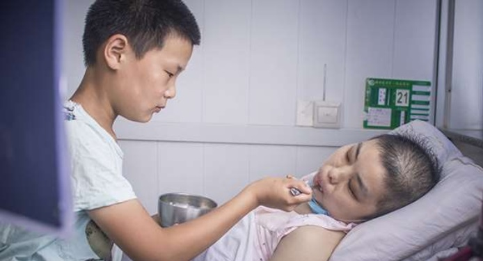 Young-Boy-Collects-Trash-So-He-Can-Help-His-Sick-Stepmother 1